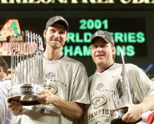 4 Nov 2001:  Co-MVP winners Randy Johnson #51 and Curt Schilling #38 of the Arizona Diamondbacks hold the trophys after winning the  World Series over the New York Yankees at Bank One Ballpark in Phoenix, Arizona. The Diamondbacks defeated the Yankees 3-2. DIGITAL IMAGE Mandatory Credit: Jed Jacobsohn/ALLSPORT